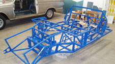 Foreground - GT40 replica chassis awaiting panelwork. Background - Bare metal restoration of Lotus Cortina
